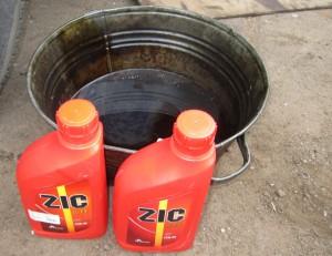 Масло ZIC и емкость для старой смазки