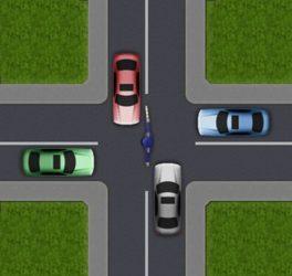 Регулировщик разрешает проезд красной и серой машинам